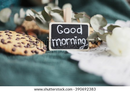 Good morning. Green knitted background. Nuts. eucalyptus. shabby chalkboard. Sweet morning. rustic.