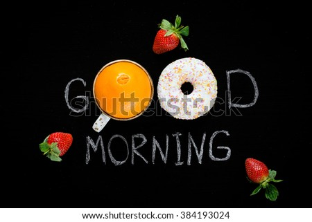 Good morning greeting written on black chalk board. Donut (doughnut), sweet orange and strawberries. Breakfast concept. Flat lay - stock photo