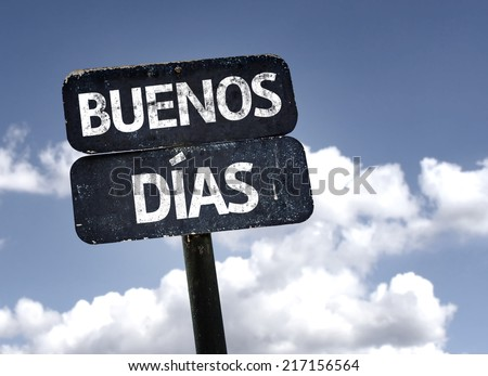 Good Morning (In Spanish) sign with clouds and sky background - stock photo