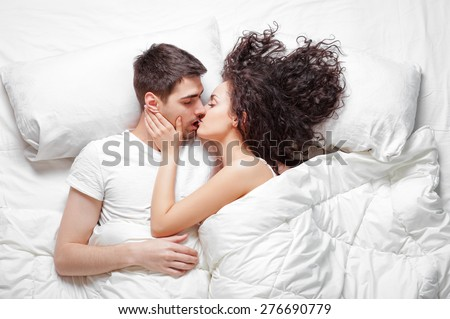 Good Morning Love And Comfort Overhead Of Happy Beautiful Young Couple Lying On The