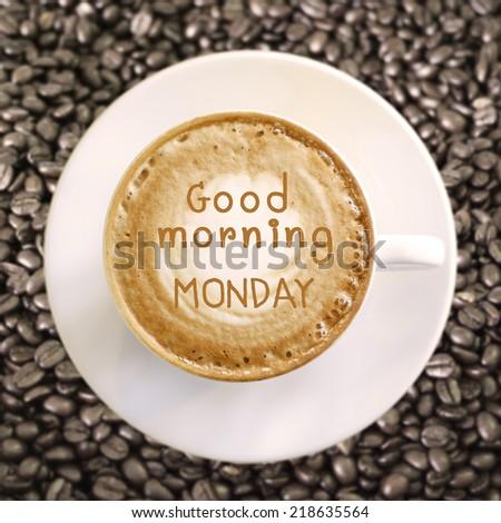 Good morning Monday on hot coffee background - stock photo