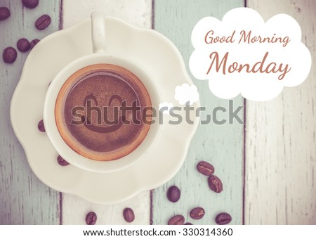 Good Morning Monday with coffee cup on table   - stock photo
