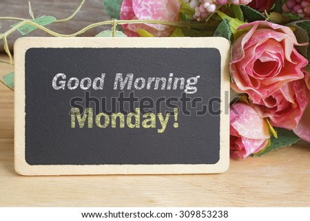 Good Morning Monday word on chalkboard with roses bouquet - stock photo