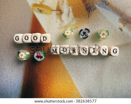 Good morning! - Small wooden cubes and caramel on a light background