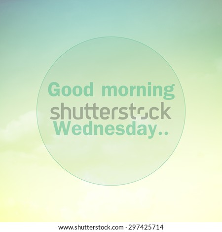 Good morning Wednesday, text on soft pastel cloud and sky - stock photo