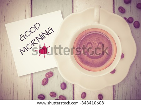 Good Morning with coffee cup on table   - stock photo