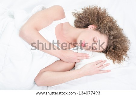 Good morning, woman lying in her bed