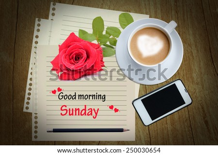 Good morning words and a cup of coffee on wood table. - stock photo