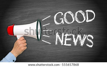 Good News - female hand with megaphone and text on chalkboard background