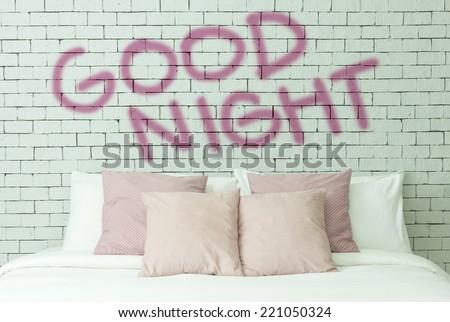 Good night concept on bricks wall background - stock photo
