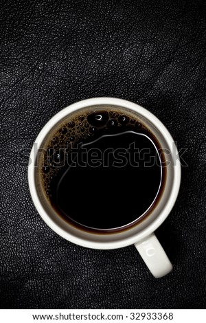 good night espresso coffee in white cup top view, black leather backdrop, shallow DOF - stock photo