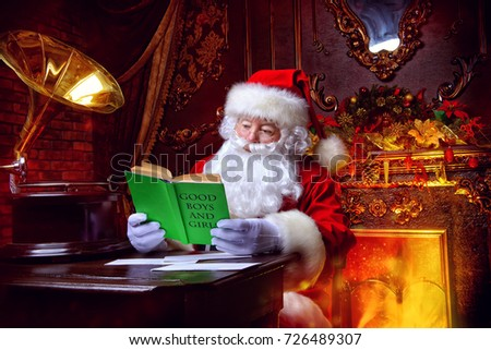 Good old Santa Claus in his house next to the fireplace and Christmas tree ready for Christmas.