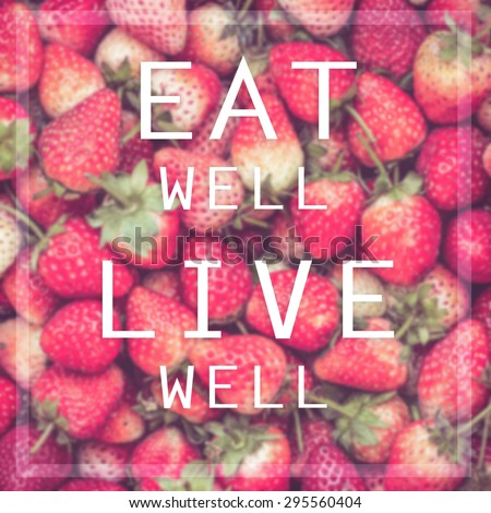 Good quote on strawberry background , Eat well live well - stock photo