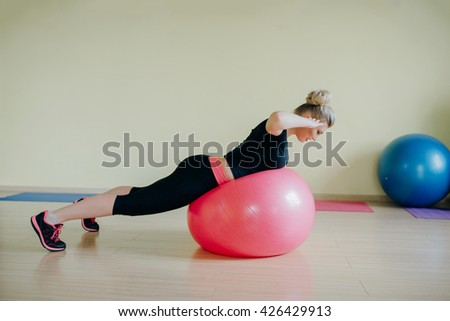 Good sports girl does stretching fitness room in the morning