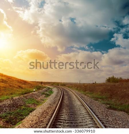 good sunset over railroad to horizon - stock photo