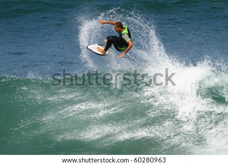 good surfer in action on a powerful wave