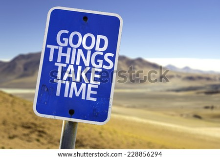 Good Things Take Time sign with a desert background - stock photo