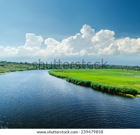 good view to river with clouds over it - stock photo