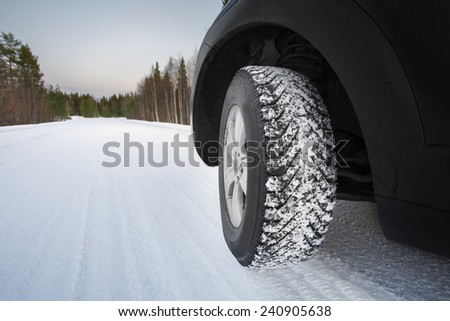 Good winter tires on snowy road - stock photo