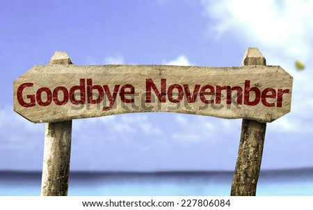 Goodbye November wooden sign with a beach on background - stock photo