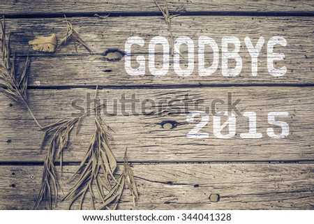 Goodbye 2015 on old wood background