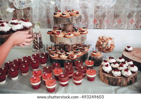 goodies and desserts standing on wedding sweet table