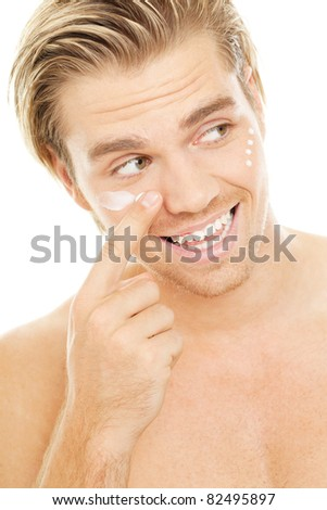 goodlooking blond man with creme - stock photo