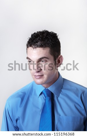 Goodlooking business man looking down to his side looking a bit sad - stock photo