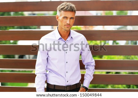 Goodlooking young man smiling confidently - stock photo