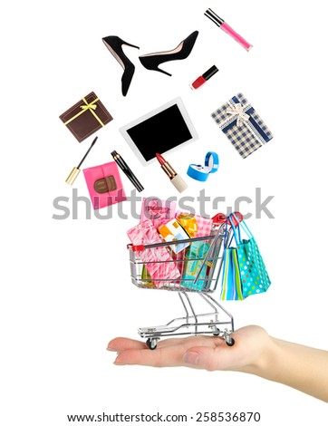 Goods falling into cart isolated on white - stock photo