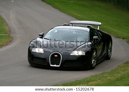Goodwood, UK, July 11, 2008: black bugatti veyron driving on track at the Goodwood Festival of Speed. - stock photo