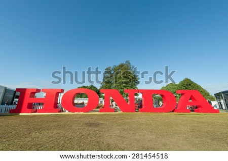 GOODWOOD, UK - JULY 1: Large Honda corporate advertising sign on display at Goodwood, UK on July 1, 2012 - stock photo