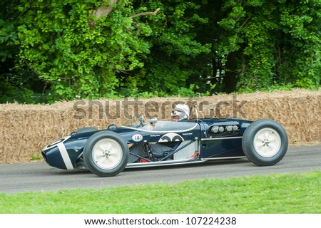 GOODWOOD, UK - JULY 1: Motor-sport legend, Stirling Moss in his classic Lotus 18 Formula 1 car on the hill course at Goodwood, UK on July 1, 2012 - stock photo