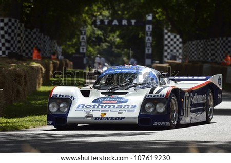 GOODWOOD, UK - JULY 1: The Porsche 962C Le Mans race car drives up the Festival of Speed hill course at Goodwood, UK on July 1, 2012