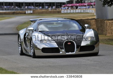 GOODWOOD, UNITED KINGDOM - JULY 3: Chrome bodied Bugatti Veyron drives up the hill at the Goodwood Festival of Speed in the United Kingdom  on July 3rd 2009 - stock photo