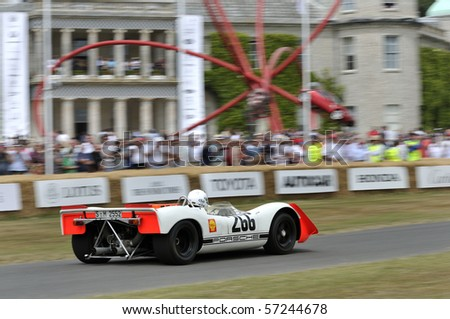 GOODWOOD, UNITED KINGDOM - JULY 3: Classic Porsche Racing Car drives up the hill at the Goodwood Festival of Speed in the United Kingdom on July 3, 2010 in Goodwood, UK - stock photo