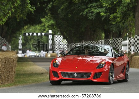 GOODWOOD, UNITED KINGDOM - JULY 3: Ferrari 599 GTO drives up the hill at the Goodwood Festival of Speed in the United Kingdom on July 3rd 2010 in Goodwood, UK - stock photo