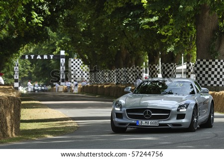 GOODWOOD, UNITED KINGDOM - JULY 3: Mercedes SLS Gull Wing drives up the hill at the Goodwood Festival of Speed in the United Kingdom on July 3, 2010 in Goodwood, UK - stock photo