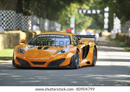 GOODWOOD, UNITED KINGDOM - JULY 3: The new McLaren MP4-12C GT3 race car drives up the hill at the Goodwood Festival of Speed in the United Kingdom on July 3rd 2011 in Goodwood, UK - stock photo