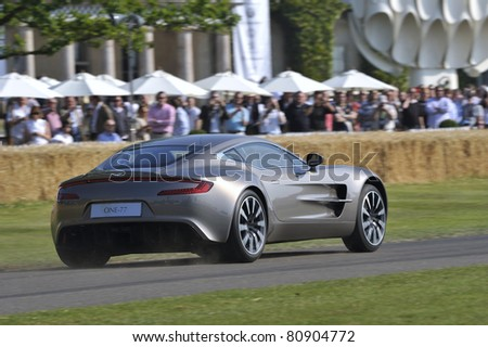 GOODWOOD, UNITED KINGDOM - JULY 3: The stunning Aston Martin One-77 drives up the hill at the Goodwood Festival of Speed in the United Kingdom on July 3rd 2010 in Goodwood, UK - stock photo