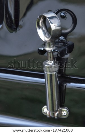 GOODWOOD, WEST SUSSEX/UK - SEPTEMBER 14 : Close-up of a bonnet release on an old Bentley car at Goodwood on September 14, 2012 - stock photo