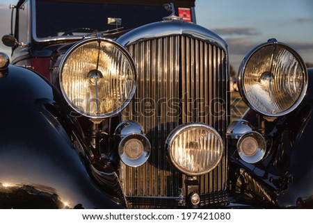GOODWOOD, WEST SUSSEX/UK - SEPTEMBER 14 : Close-up of the front of vintage Bentley at Goodwood on SEPTEMBER 14, 2012 - stock photo