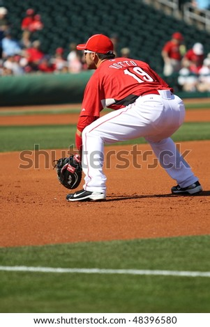 GOODYEAR, AZ - MARCH 5:Joey Votto, first baseman for the Cincinnati Reds, prepares to field a grounder in the Reds' inaugural Cactus League game March 5, 2010 at Goodyear Ballpark, Goodyear, Arizona.
