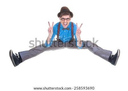 goofy, nerd geek jumping and shouting with v sign - stock photo