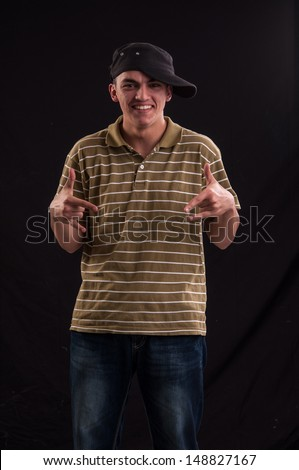 Goofy teenager wearing trendy cap, with a funny expression on his face