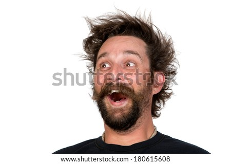 Goofy young man, with full beard and moustache and wild hair style, screams with joy. Studio portrait over white. Space for your text. - stock photo