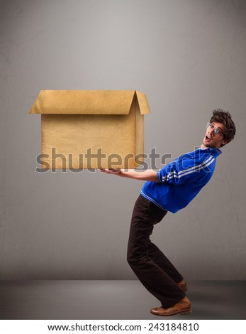 Goog-looking young man holding an empty brown cardboard box - stock photo