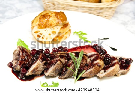 goose breast with vegetables on a white plate - stock photo