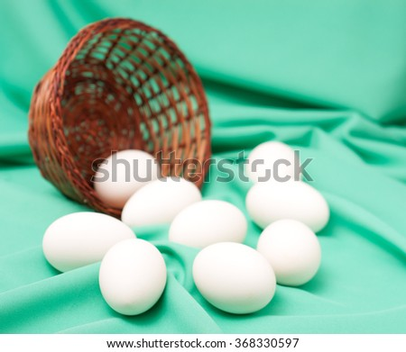goose eggs on green  background.