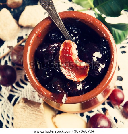 Gooseberry jam in the pot with fresh Gooseberries and ginger, top view, instagram style filter - stock photo